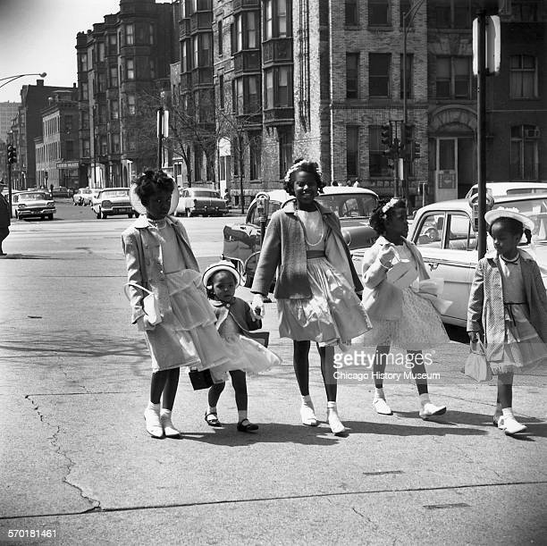 Five young girls dressed for Easter Sunday, Chicago, Illinois, circa 1962.