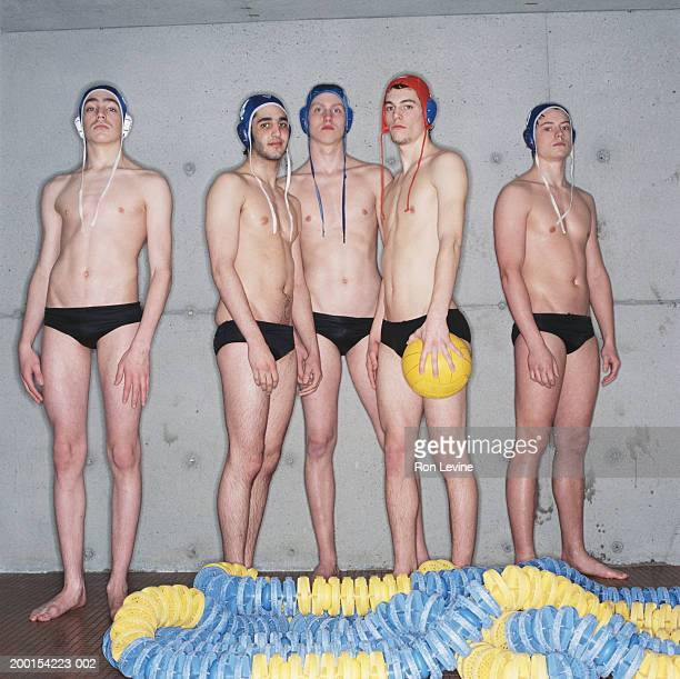 five young male waterpolo players, portrait - man wearing speedo stock photos and pictures