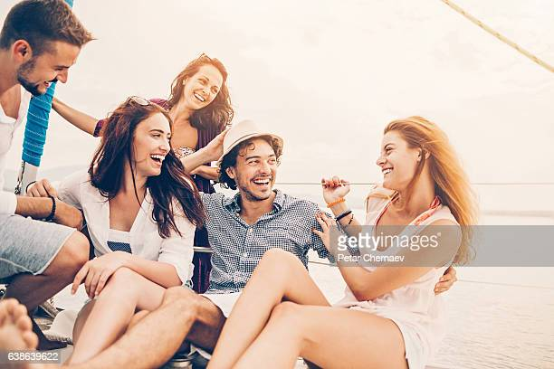 Five young people enjoying a yacht trip