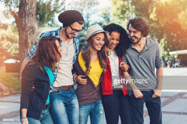 Five young people having fun together