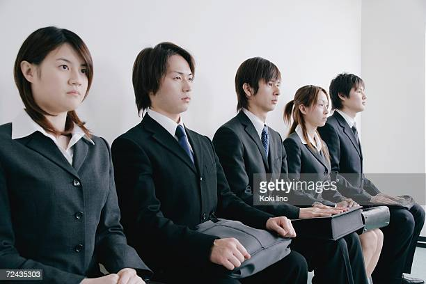 Five young people waiting for job interview