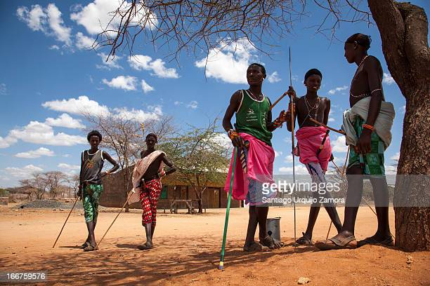 CONTENT] Five young Samburu warriors with their spears in the shade of an acacia tree in the village of Serolevi Rift Valley Kenya The Samburu are...