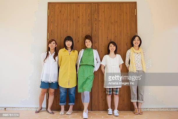 Five Young Women Leaning on Doors