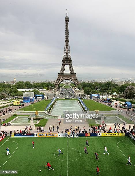 A fiveaside football match takes place at UEFA's Champions Festival site by the Eiffel Tower in preparation for tomorrow's Champions League final...