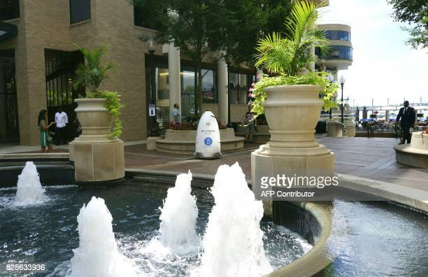 A fivefoot tall outdoor K5 security robot patrols the grounds of the Washington Harbour retailresidential center in the Georgetown district of...