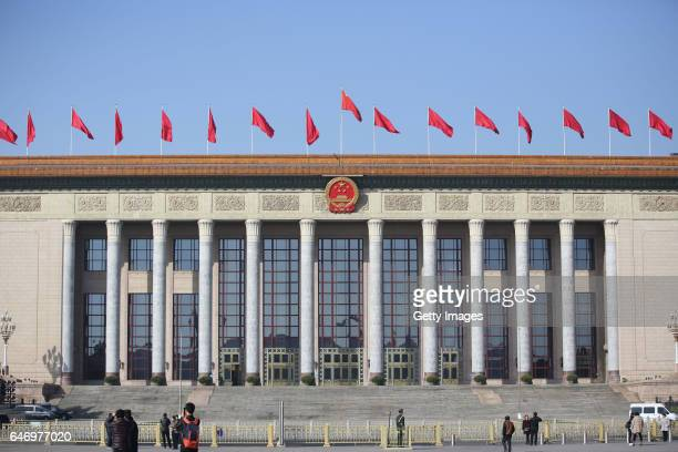 Fivestar red flags atop the Great Hall of the People flutter to welcome the upcoming Fifth Session of the 12th NPC and the Fifth Session of the 12th...