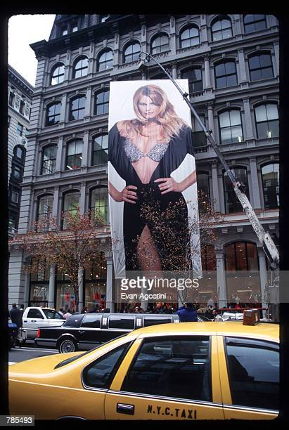 A fivestory likeness of Claudia Schiffer is on display December 4 1996 in New York City Schiffer unveiled one of the four new Victoria's Secret...