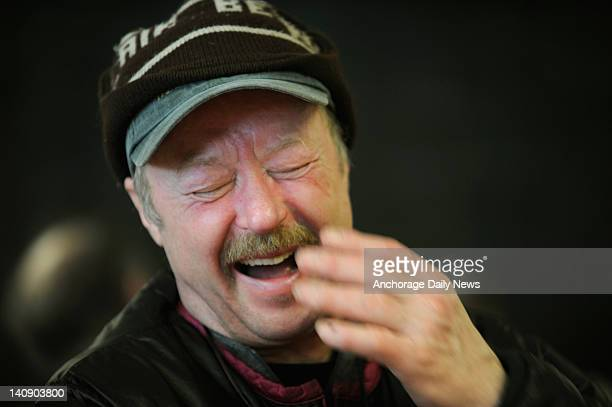 Fivetime Iditarod winner Rick Swenson laughs while talking with other mushers in Takotna Alaska during the Iditarod Trail Sled Dog Race on Wednesday...
