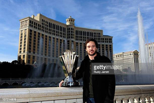 Five-time NASCAR Sprint Cup Series Champion Jimmie Johnson poses with the 2010 trophy outside the Bellagio Hotel and Casino Resort during Day 1 of...