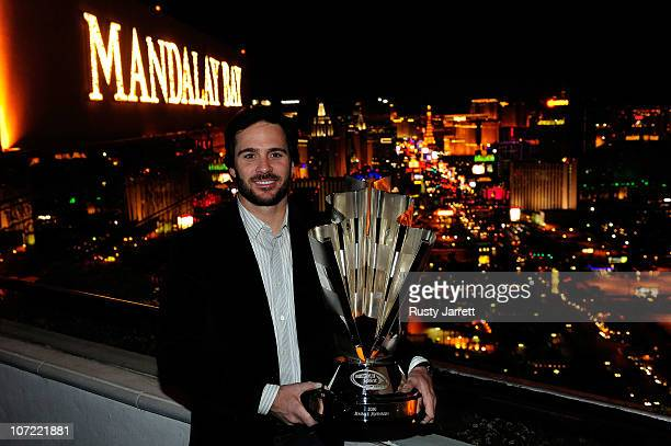 Five-time NASCAR Sprint Cup Series Champion Jimmie Johnson poses with the 2010 trophy at the House of Blues Foundation Room inside Mandalay Bay...