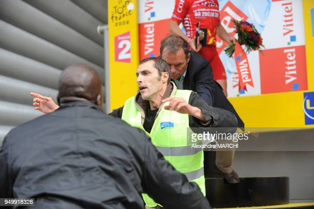 Fivetime Tour de France winner Bernard Hinault push away from the podium an antiairport protestor on July 7 2008 in Nantes at the end of the 208 km...