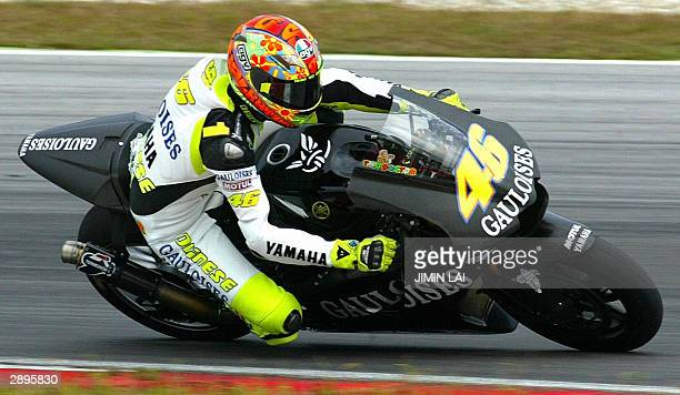 Five-time world champion Valentino Rossi tests his new Yamaha bike for the first time at the Sepang circuit in Malaysia, 24 January 2004. Rossi...