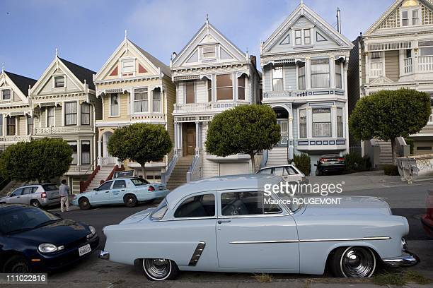 A fiveyear Ford before the historic houses in Nob Hill Illustration San Francisco in San Francisco United States on September 04th 2007
