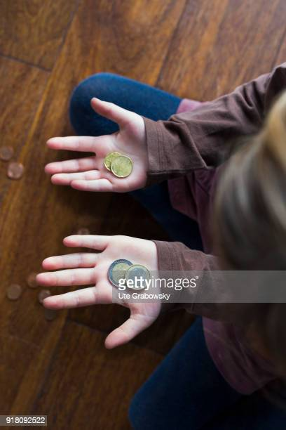 Five-year old girl shows her pocket money on February 03, 2018 in Bonn, Germany.