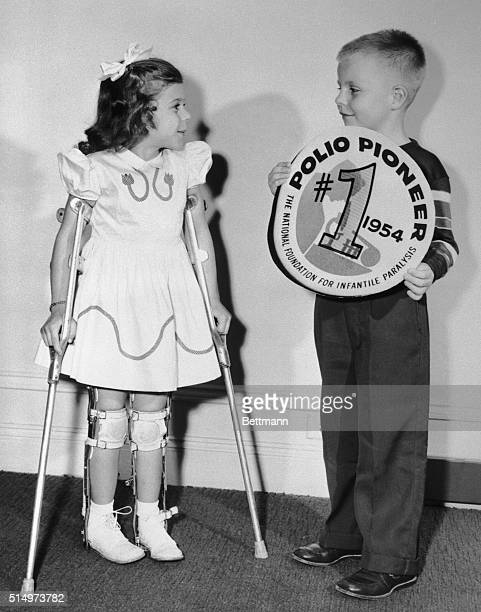 Five-year old Mary Kosloski, 1955 March of Dimes Poster girl from Collierville, Tennessee, meets seven year old Randy Kerr, of Falls Church, VA., the...