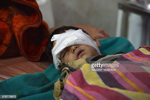 TOPSHOT Fiveyear old Nasir Ahmed Khan sleeps in a hospital in Srinagar on July 22 after he was allegedly beaten up and hit in the eye with a baton by...