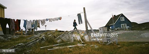 Fiveyearold Angut Rosbach and his fouryearold cousin Nikki Lange play outside their house August 26 2007 at the village of Ilimanaq Greenland The...