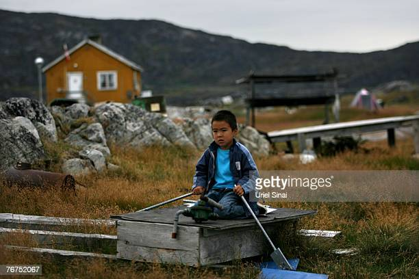Fiveyearold Angut Rosbach plays in his back yard August 26 2007 in the village of Ilimanaq Greenland Agnut's father Arne Lange has largely given up...