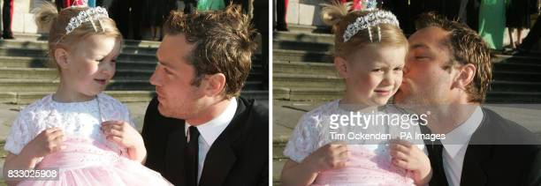 Fiveyearold Ellie Stirling is kissed by film star Jude Law during the Make a Wish Foundation annual ball at Blenheim Palace Oxfordshire