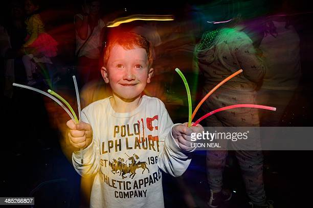 Fiveyearold Jack holds glowstick as he enjoys the music and entertainment at the Big Fish Little Fish '24 Hour Party People' event in Brixton South...