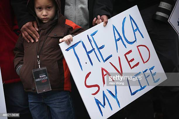 Fiveyearold James Cook of Cleveland Ohio participates in a rally to support the Affordable Care Act in front of the US Supreme Court March 4 2015 in...