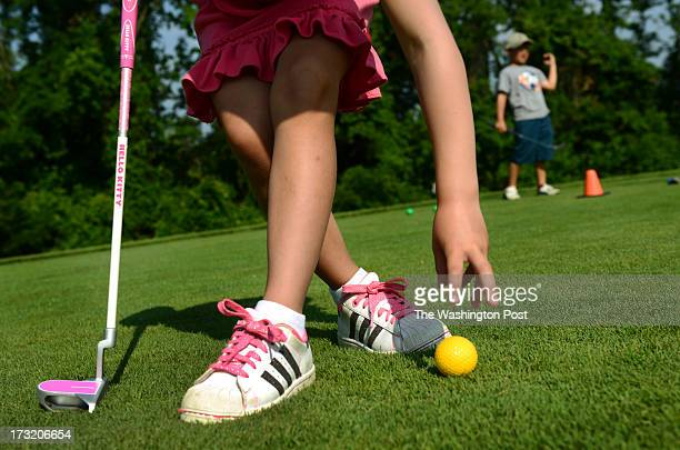Five-year-old Katy Asher places her ball to put sporting Hello Kitty clubs and matching pink outfit at the Troy Beck Golf Academy in Glenn Dale, MD...