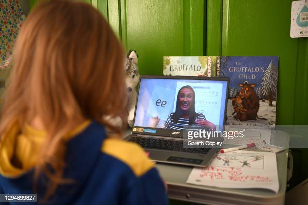 Five-year-old Lois Copley-Jones, who is the photographer's daughter, watches an online phonics lesson on a laptop in her bedroom on the second day of...