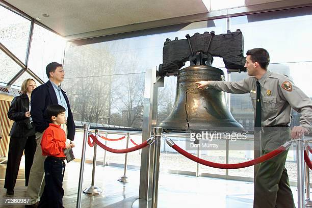 Fiveyearold Phillip Africa stands with his father Candido as Park Ranger Ethan Betten explains the larger of two cracks in the Liberty Bell February...