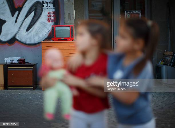 Fiveyearold twin sisters Kiomara and Tatiana Laguna Arias who were evicted with their parents and brother almost a year ago stand beside their...