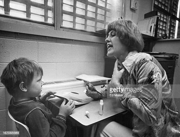 APR 26 1977 MAY 2 1977 Fiveyearold Woody Sinor listens carefully how to say the 'kah' sound in cat demonstrated by Karen Bruner speech pathologist...