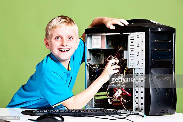 Fixed it! Young boy practises his computer technician skills