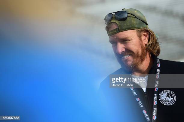 'Fixer Upper' star and honorary pace car driver Chip Gaines looks on prior to the Monster Energy NASCAR Cup Series AAA Texas 500 pace car at Texas...