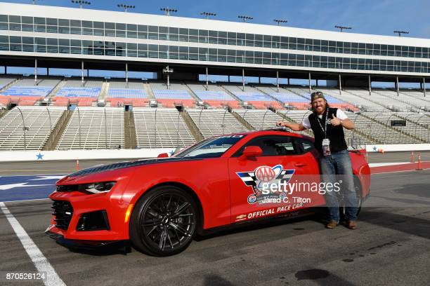 'Fixer Upper' star Chip Gaines poses with the Monster Energy NASCAR Cup Series AAA Texas 500 pace car at Texas Motor Speedway on November 5 2017 in...