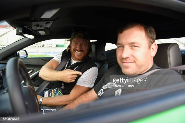 'Fixer Upper' star Chip Gaines sits with Ryan Newman driver of the Grainger Chevrolet in the Monster Energy NASCAR Cup Series AAA Texas 500 pace car...