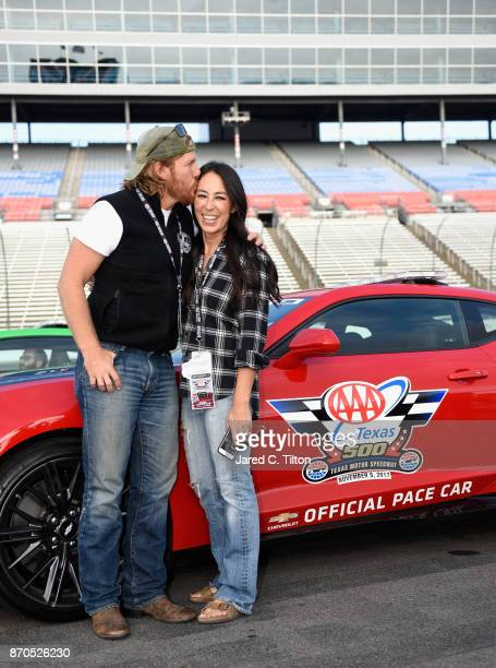 'Fixer Upper' stars Chip and Joanna Gaines pose with the Monster Energy NASCAR Cup Series AAA Texas 500 pace car at Texas Motor Speedway on November...