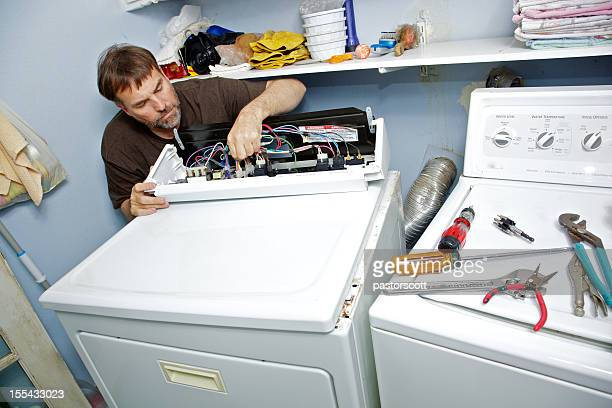 fixing a clothes dryer - appliance stock pictures, royalty-free photos & images