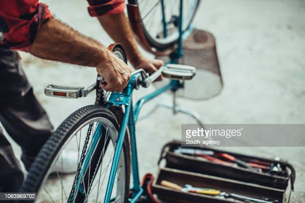 fixing bicycle - adjusting stock pictures, royalty-free photos & images