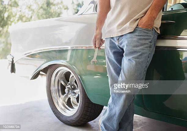 fixing cars - vintage auto repair stock pictures, royalty-free photos & images