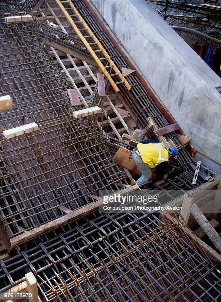 Fixing shuttering prior to concrete pour Canning Town London Underground station London United Kingdom