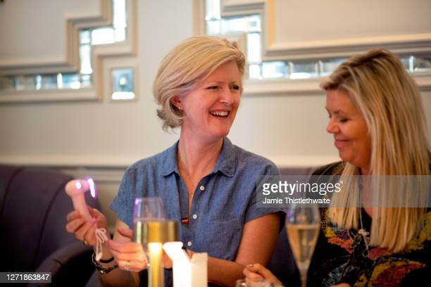 """Fizz Milton and Jacquie Lawrence share a moment during the """"Henpire"""" podcast launch event at Langham Hotel on September 10, 2020 in London, England."""