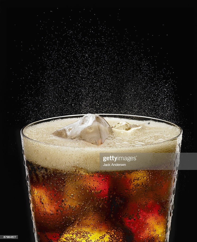 Fizzy glass of cola : Stock Photo