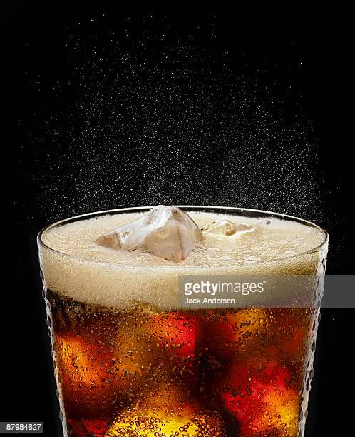 fizzy glass of cola - pepsi stock pictures, royalty-free photos & images