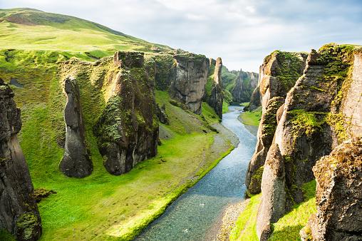 Fjadrargljufur canyon with river and big rocks. 614626432