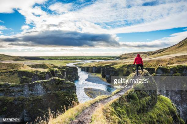 fjadrargljufur, iceland, europe. a man admires the panorama - iceland stock pictures, royalty-free photos & images