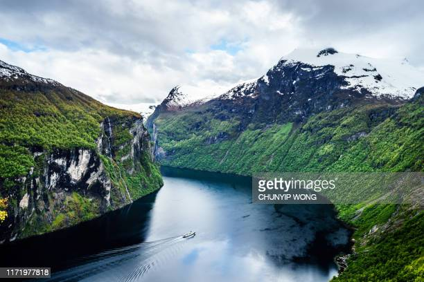 fjord in the clouds - norway stock pictures, royalty-free photos & images