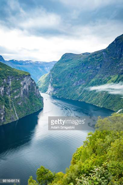 fjord in the clouds - traditionally norwegian stock pictures, royalty-free photos & images