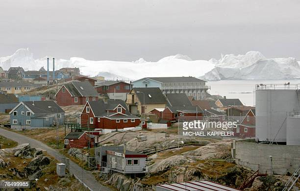 A fjord is seen behind the town of Ilulissat in Greenland 16 August 2007 German Chancellor Angela Merkel and German Environment Minister Sigmar...
