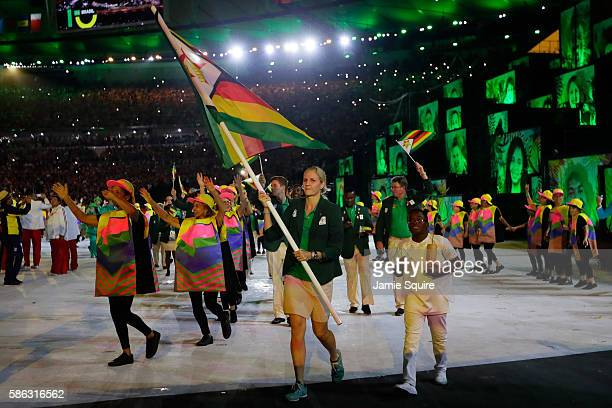Flab bearer Kirsty Coventry of Zimbabwe leads her team during the Opening Ceremony of the Rio 2016 Olympic Games at Maracana Stadium on August 5,...