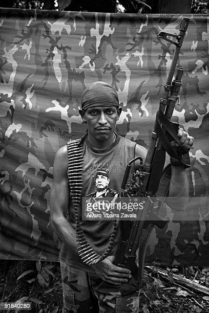 Flaco a FARC guerrilla from the bloque movil Arturo Ruiz inside one of the FARC camps The Bloque Movil Arturo Ruiz of the revolutionary armed forces...