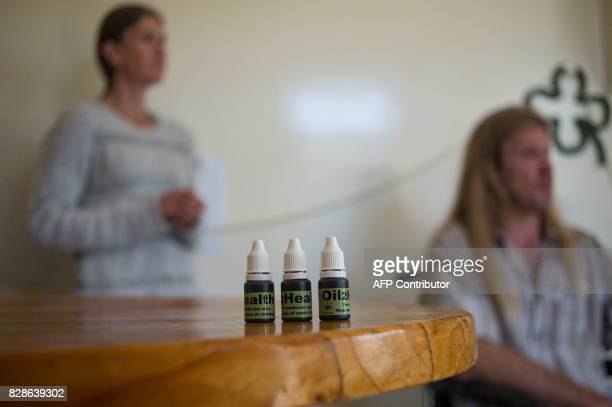 Flacons with cannabis oil are seen at the home of South African Gerd Bader affected by Multiple Sclerosis on July 18 2017 in Johannesburg South...